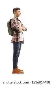Full length profile shot of a teenage male student standing and waiting isolated on white background