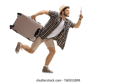 Full length profile shot of a tourist with a suitcase and a passport running isolated on white background