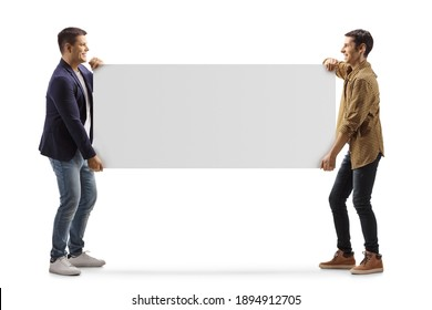 Full length profile shot of two casual men carrying a blank panel isolated on white background