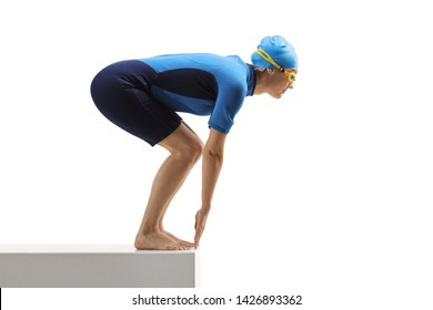 Full length profile shot of a woman in a wetsuit preparing to jump for a swim isolated on white background