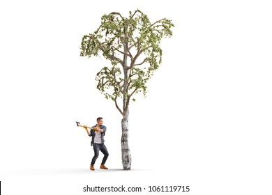 Full length profile shot of a young man with an axe cutting a tree isolated on white background