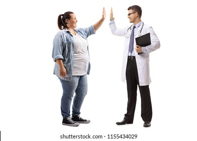 Full length profile shot of a young woman high-fiving a doctor isolated on white background