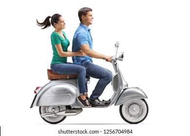Full length profile shot of a young couple riding on a vintage motorbike isolated on white background