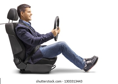 Full length profile shot of a young man in a car seat with a fastened seat belt holding a streering wheel isolated on white background