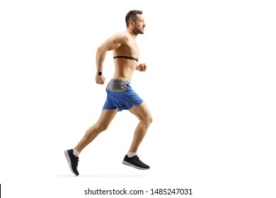 Full length profile shot of a young man running and wearing a chest strap monitor isolated on white background