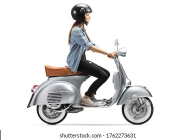 Full length profile shot of a young woman with a helmet riding a vintage scooter isolated on white background
