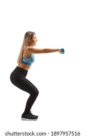 Full length profile shot of a young woman in sportswear exercising with small blue weigths isolated on white background