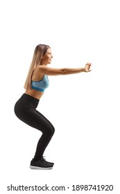 Full length profile shot of a young woman in sportswear exercising squats isolated on white background