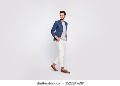 Full length profile side photo of pretty youth walk look wear blazer jacket pants trousers boat-shoes isolated over white background