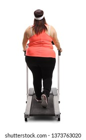 Full length rear view of a corpulent woman on a treadmill isolated on white background