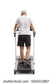 Full length rear view shot of a mature man walking on a treadmill isolated on white background