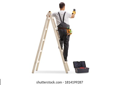 Full length rear view shot of a repairman on a ladder drilling with a machine into a wall isolated on white background