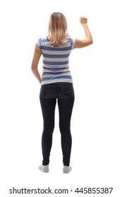 Full length rear view shot of a young woman knocking on a door isolated on white background