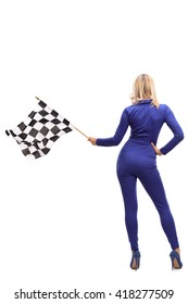 Full length rear view studio shot of a racing woman waving a checkered race flag isolated on white background