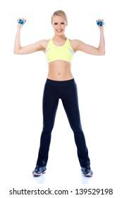 Full length shoot of sporty female with dumbbell over white background