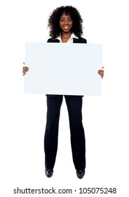 Full length shot of african lady promoting big blank banner ad