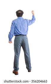 Full Length Shot of an Angry Businessman Raising Fist While Facing Backward, Isolated on a White Background.