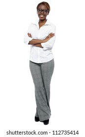 Full length shot of attractive female consultant. Arms folded and legs crossed