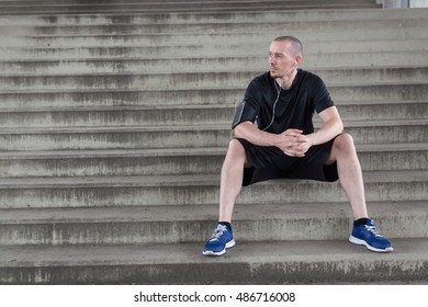 Full length shot of an attractive young athlete sitting down after an outdoor workout