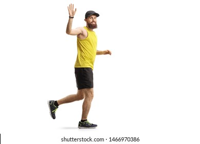 Full length shot of a bearded man jogging and waving isolated on white background