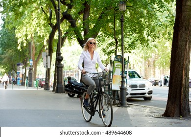 Full length shot of a beautiful mature woman traveling by bike in the city.
