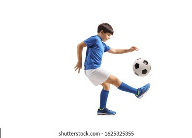 Full length shot of a boy football player juggling with a soccer ball isolated on white background