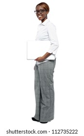 Full length shot of businesswoman with laptop isolated over white