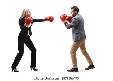 Full length shot of a businesswoman punching a man with boxing gloves isolated on white background