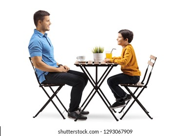 Full length shot of a father and son at a coffee table isolated on white background