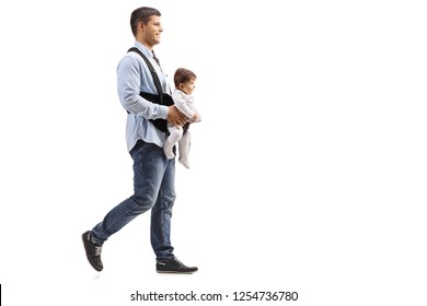 Full length shot of a father walking with a baby in carrier  isolated on white background