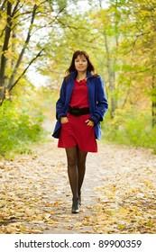 Full length shot of girl  in autumn