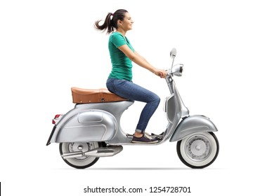 Full length shot of a girl riding a vintage scooter isolated on white background