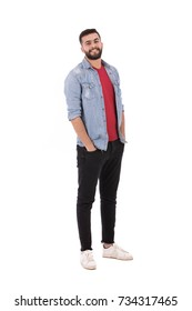 Full length shot of handsome beard man wearing jeans shirt and black pants, guy smiling and looking to you, isolated on white background