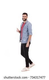 Full length shot of handsome beard man wearing jeans shirt and black pants, guy smiling and thumbs up, isolated on white background