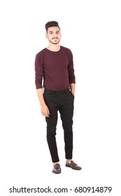 Full length shot of handsome happy young man smiling and standing confidently , guy wearing brown t-shirt and black jeans with brown shoes, isolated on white background