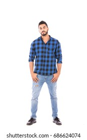 Full length shot of handsome happy beard young man standing confidently, guy wearing blue caro shirt and jeans, isolated on white background