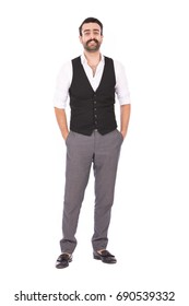 Full length shot of handsome happy beard man smiling and standing confidently, guy wearing white shirt and black vest with gray trousers, isolated on white background