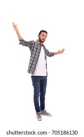 Full length shot of handsome happy excited beard young man smiling and rising his hands, guy wearing caro shirt and jeans, isolated on white background
