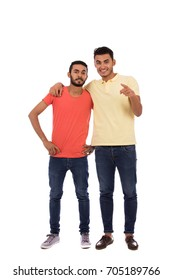 Full length shot of handsome happy friendly young men smiling and looking to you, guys wearing casual t-shirts and jeans, isolated on white background