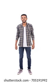Full length shot of handsome happy beard young man smiling and looking to you, guy wearing caro shirt and jeans, isolated on white background
