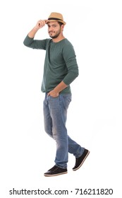 Full length shot of handsome man wearing green T-shirt and jeans, guy smiling and standing confidently, isolated on white background