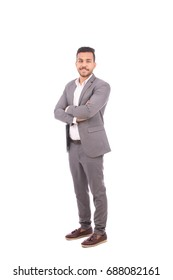 Full length shot of handsome young businessman smiling and standing confidently, guy wearing gray suit, isolated on white background