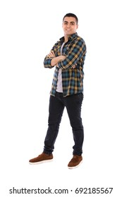 Full length shot of a happy handsome young man smiling and standing confidently, guy wearing caro shirt and jeans with brown shoes, isolated on white background