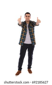 Full length shot of a happy handsome young man smiling and thumbs up, guy wearing caro shirt and jeans with brown shoes, isolated on white background