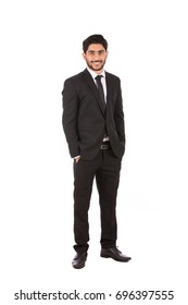 Full length shot of a happy handsome young businessman with hand in pocket smiling and looking to you, guy wearing black suit and black tie, isolated on white background