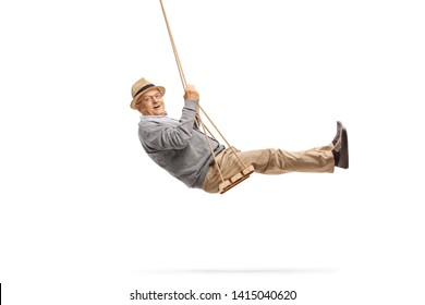 Full length shot of a happy senior swinging on a wooden swing isolated on white background
