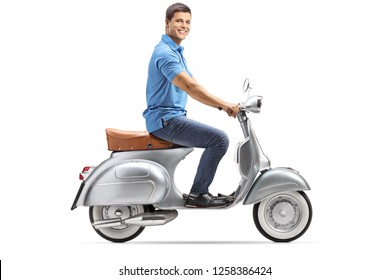 Full length shot of a happy young man riding a vintage scooter and looking at the camera isolated on white background