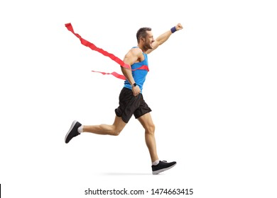 Full length shot of a male athlete on the finish line of a race gesturing happiness isolated on white background