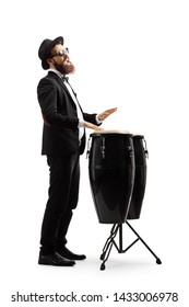 Full length shot of a man in a black suit playing conga drums isolated on white background