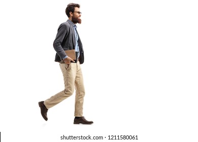 Full length shot of a man holding books and walking isolated on white background